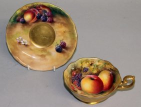 A Royal Worcester Fruit Painted Scallop Edged Teacup