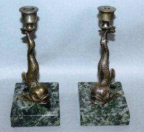 A Pair Of Bronze Dolphin Candlesticks On Marble Bases.