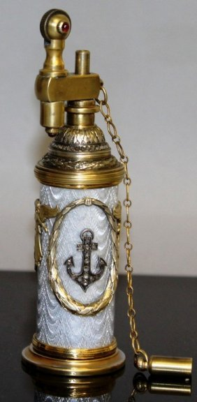 """A """"faberge"""" Silver And Enamel Drum Shaped Lighter With"""
