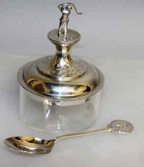 A Silver Mounted Golf Trophy And A Spoon.