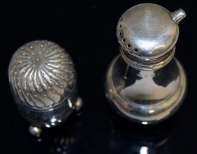 A Silver Pepperette And Silver Oil Pot.