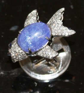 A Cabochon Sapphire And Diamond Fish Ring.