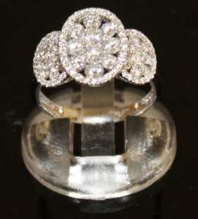 A Good Triple Diamond Oval Panel Ring, Set With Thirty