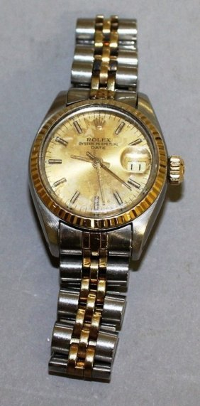 A Ladies Rolex Gold And Silver Day Date Wristwatch In