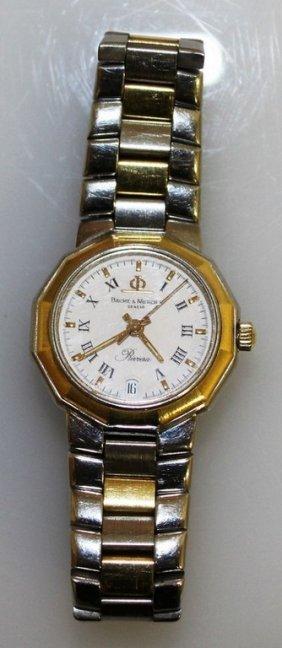 A Ladies Two-colour Baume & Mercier Wristwatch.