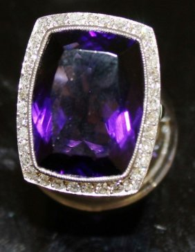 A Large Amethyst And Diamond Dress Ring Set In 18ct