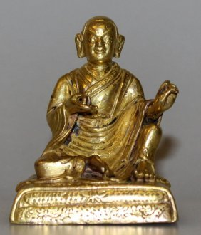 A Small Sino-tibetan Gilt Bronze Figure Of A Lama, The