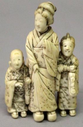 A Small Japanese Meiji Period Ivory Okimono Group, Of A