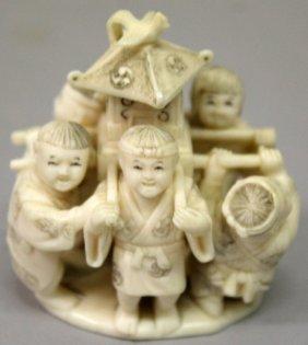A Small Japanese Meiji Period Ivory Okimono Of A Group