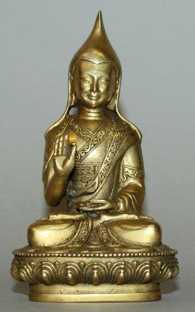 A Tibetan Gilt Bronze Figure Of A Lama, The Priest