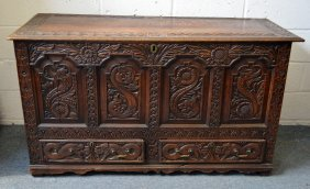 4. An 18th Century Carved Oak Marriage Chest, With