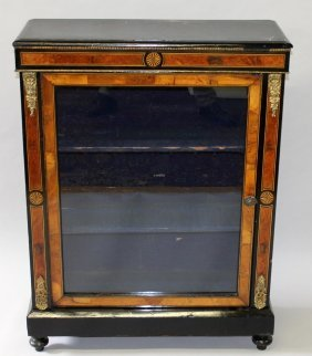 13. A Victorian Ebonised And Inlaid Pier Cabinet With