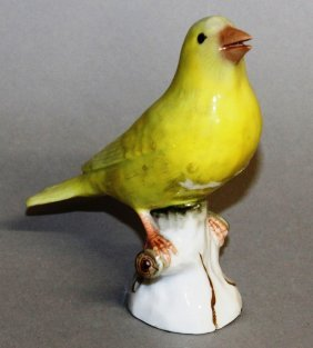 146. A Small Meissen Porcelain Yellow Bird On A Tree