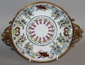 185. A French Porcelain Circular Dish With Ormolu