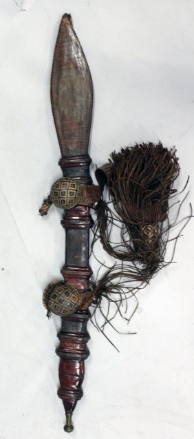 449. A Tribal Sword In A Leather Scabbard.