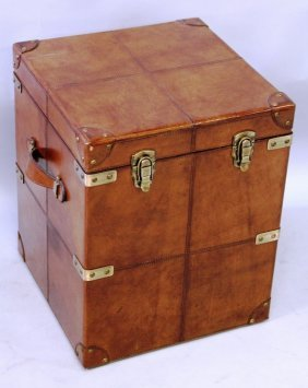 519. A Square Leather Trunk With Brass Mounts And