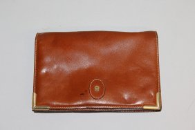 524. An Etienne Aigner Leather Purse.