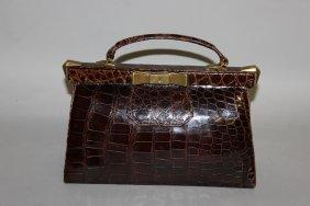 533. A Black Crocodile Handbag.