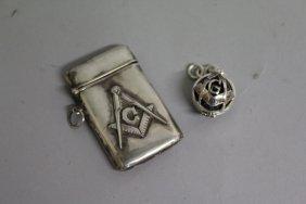 559. A Silver Masonic Vesta And A Fob.