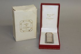 607. A Cartier Silver Lighter, In Red Cartier Box.