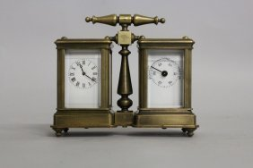618. A Double Miniature Brass Carriage Clock And