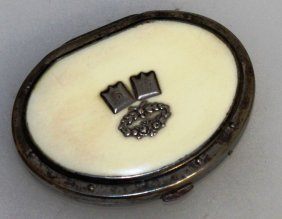 645. A Victorian Metal Mounted Ivory Purse.