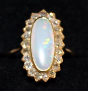704. A Large Opal And Diamond Cluster Ring, Set In