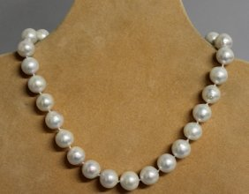 839. A 15mm Freshwater Pearl Necklace, With 15ct