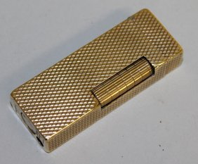 878. A 9ct Gold Dunhill Lighter.