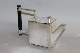 901. A Christopher Dresser Design Teapot With Wooden