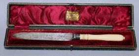 946. An Engraved Silver Bladed Cake Knife With Ivory