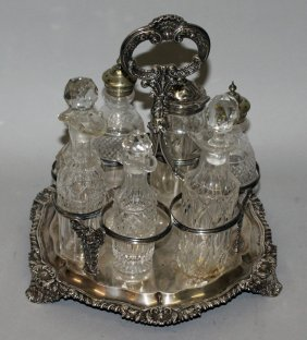 976. A George Iv Seven Bottle Cruet With Gadrooned