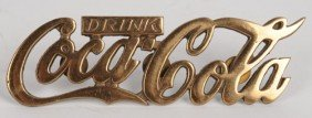 COCA-COLA BRASS SCRIPT CUT-OUT DRIVER'S HAT LOGO