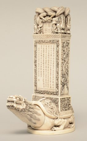 A Chinese Pierced Ivory Model Of A Stele Supported On A