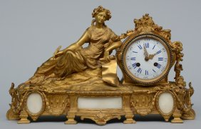 A Neo-classical Gilt Bronze Clock With Allegorical