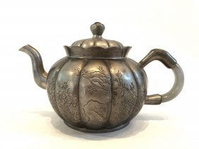 A Pewter Teapot With Cover