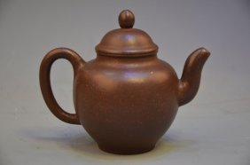A Chinese Yixing Stoneware Teapot With Cover