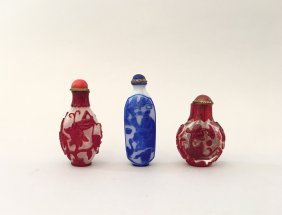 A Group Of Three Chinese Overlay Glass Snuff Bottles