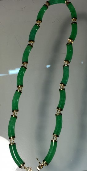 A Jadeite Necklace With Gold Links