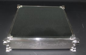 An Unusual Mirror Glass Topped Silver Plated Wedding
