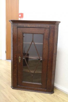 An Early 20th Century Oak Hanging Corner Cupboard With