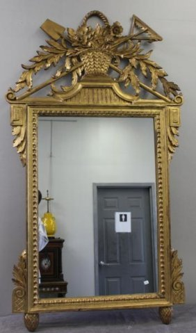 Italian Gilt Mirror With Basket Of Flower Motif.