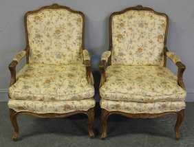 Pair Of French Upholstered Open Arm Chairs.