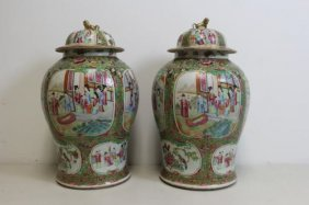 Pair Of Chinese Rose Medallion Export Lidded Urns.