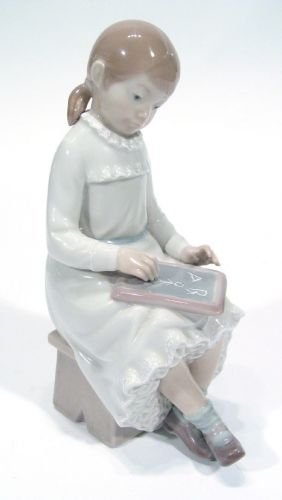 Hand Painted Nao Figurine Of A Young Girl With Bla