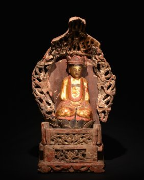 A Lacquered Wood Figure Of Buddha