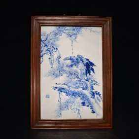 A Blue And White Wall Plaque