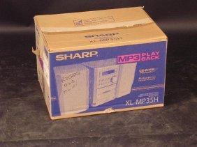 A SHARP MICRO SYSTEM, MODEL XL-MP35H, IN ORIGINAL