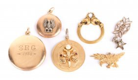A Collection Of Lockets And Charms