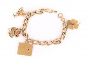 A Lady's Charm Bracelet In 14k Gold